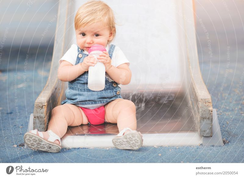 Baby in the playground Human being Joy Eating Lifestyle Emotions Funny Feminine Food Nutrition Growth Infancy Happiness Smiling Baby Drinking Breakfast