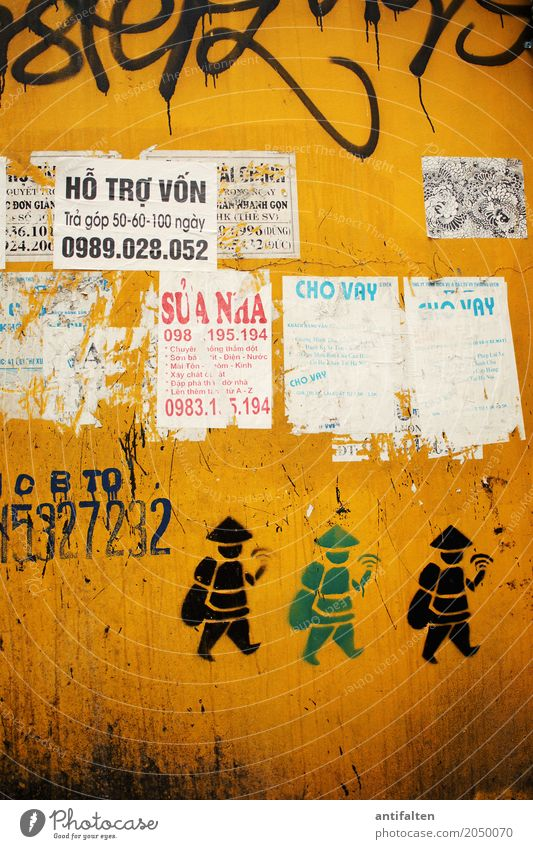 Vacation & Travel Town Yellow Wall (building) Graffiti Wall (barrier) Art Tourism Facade Design Characters Sign Illustration Digits and numbers Capital city Asia