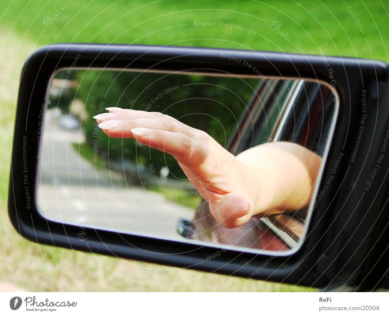 Hand in rearview mirror Rear view mirror Driving Transport Fingers Mirror Car Street Sun Beautiful weather