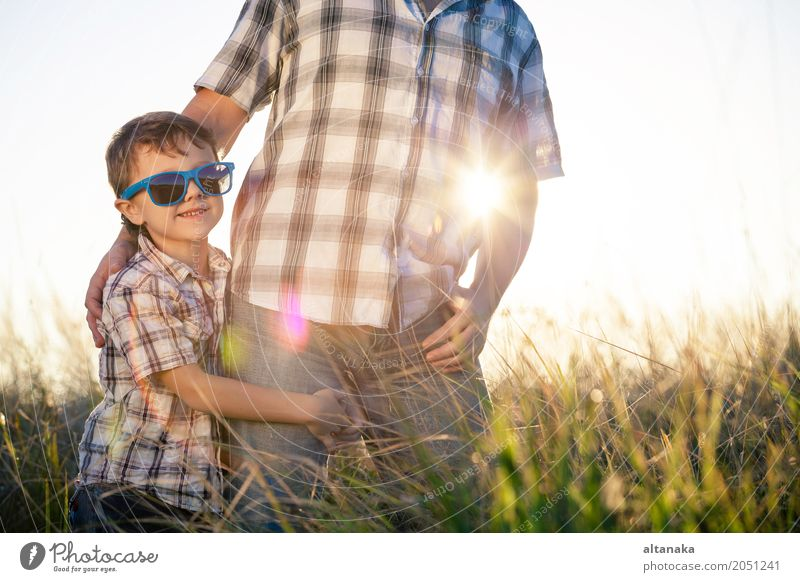 Father and son playing on the field at the day time. People having fun outdoors. Concept of friendly family. Lifestyle Joy Relaxation Leisure and hobbies