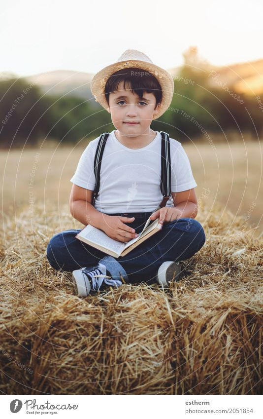 Boy reading a book Lifestyle Leisure and hobbies Reading Vacation & Travel Adventure Education Schoolchild Student Human being Masculine Child Toddler