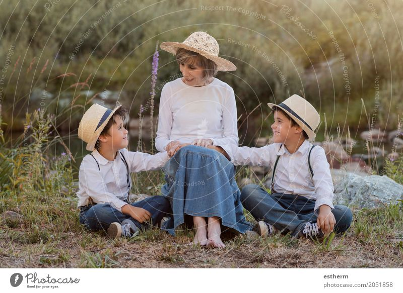 Grandmother with her grandchildren sitting in the field Lifestyle Joy Garden Human being Masculine Feminine Child Toddler Boy (child) Brothers and sisters
