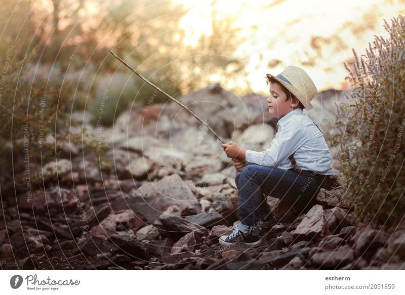 Pensive boy on the river Lifestyle Playing Fishing (Angle) Human being Child Toddler Boy (child) Infancy 1 3 - 8 years Nature River Hat Smiling Emotions Joy
