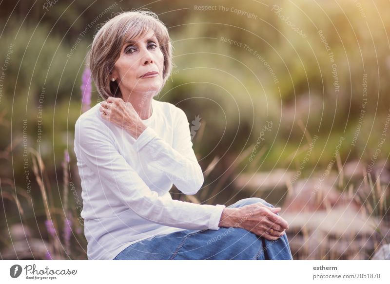 Happy senior woman sitting on the grass Human being Woman Nature Old Beautiful Relaxation Joy Adults Life Lifestyle Senior citizen Emotions Meadow Feminine