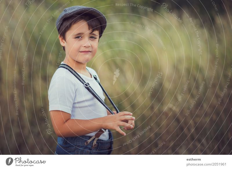 happy kid smiling at camera Lifestyle Human being Child Toddler Boy (child) Infancy 1 3 - 8 years Nature Garden Park Cap Smiling Laughter Funny Emotions Joy