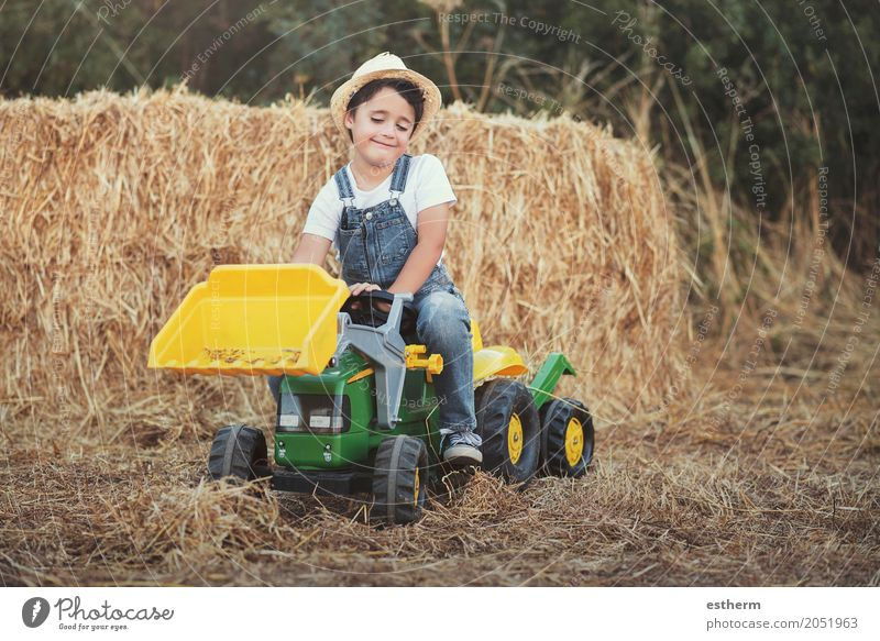 Child playing with toy tractor on meadow Human being Vacation & Travel Joy Lifestyle Emotions Boy (child) Laughter Playing Happy Garden Infancy Sit Happiness