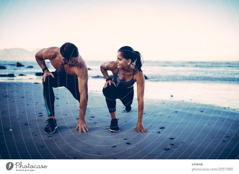 Adult fitness couple doing exercise together on beach Lifestyle Joy Body Beach Ocean Sports Young woman Youth (Young adults) Young man Couple 2 Human being