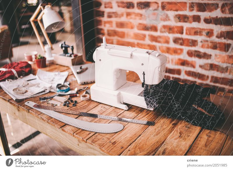 Desk of fashion designer with sewing machine and tools Lifestyle Business Work and employment Bright Office Modern Creativity Profession Factory Chaos Desk Career Home Craft (trade) Workplace Tool