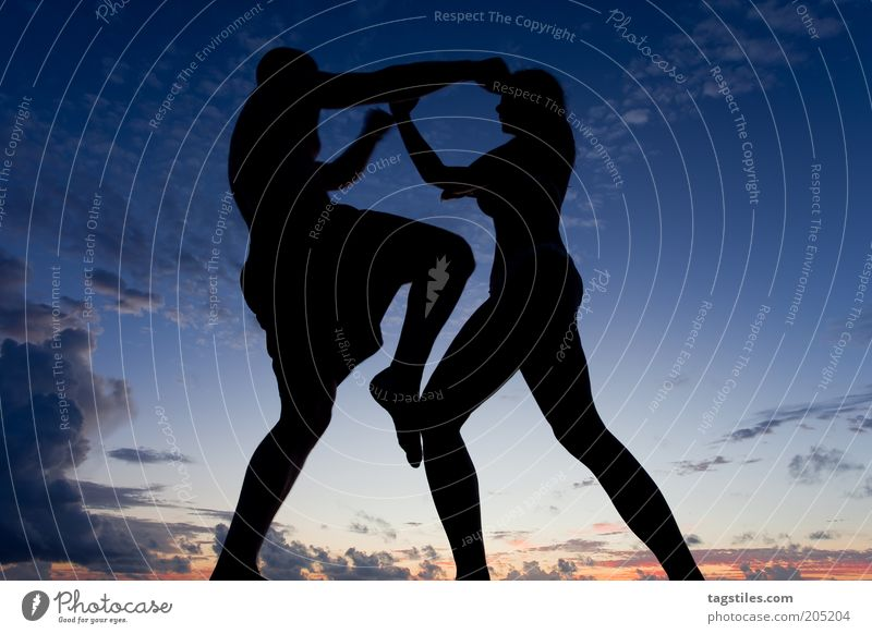 Woman Man Clouds Sports Argument Dynamics Night Athletic Fight Dusk Evening Human being Logo Martial arts Defensive Attack