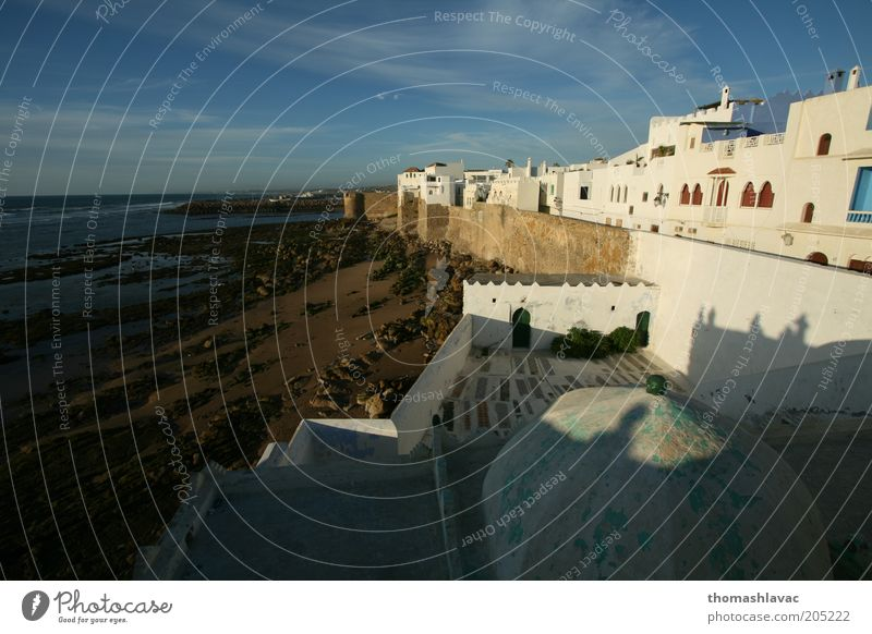 Fishing village Sky Nature Vacation & Travel Beach House (Residential Structure) Environment Landscape Wall (building) Coast Wall (barrier) Building Waves Facade Beautiful weather Africa Morocco
