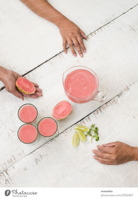 guave smoothie on white table Vegetable Fruit Nutrition Eating Vegetarian diet Diet Juice Lifestyle Healthy Eating Summer Woman Adults Hand 3 Human being Wood