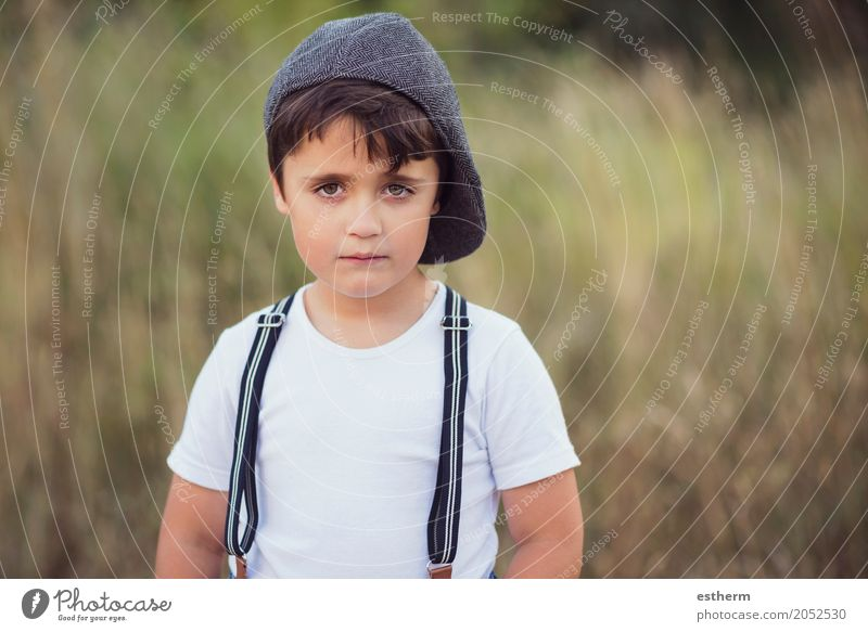 pensive boy Lifestyle Human being Masculine Child Toddler Boy (child) Infancy 1 3 - 8 years Nature Spring Summer Park Forest Cap Joy Happiness Curiosity Hope