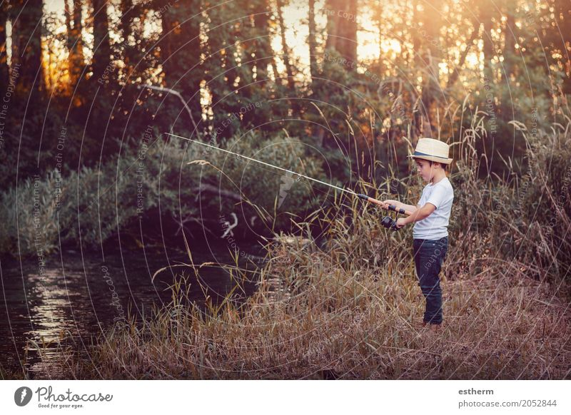 Young boy fishing Human being Child Nature Vacation & Travel Relaxation Joy Forest Lifestyle Meadow Healthy Boy (child) Happy Freedom Leisure and hobbies Park