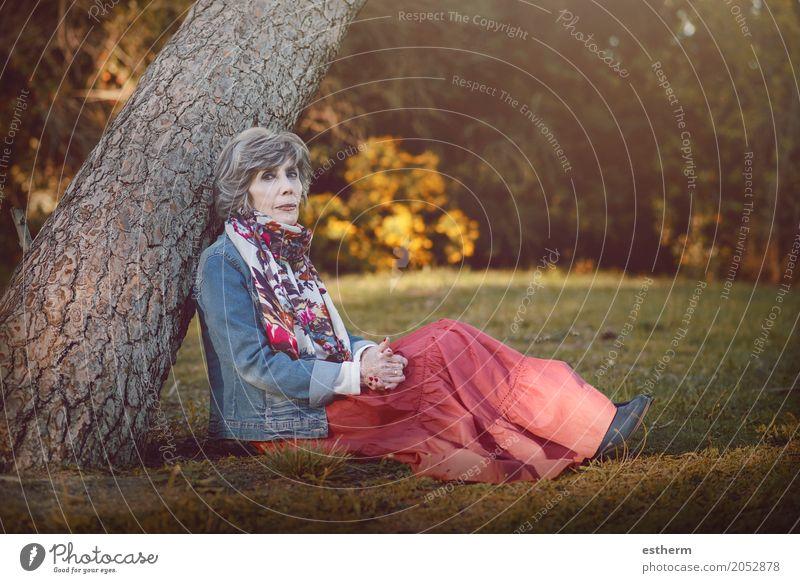 Happy senior woman sitting on the grass Human being Woman Loneliness Calm Joy Adults Life Lifestyle Love Senior citizen Emotions Feminine Garden Moody Dream
