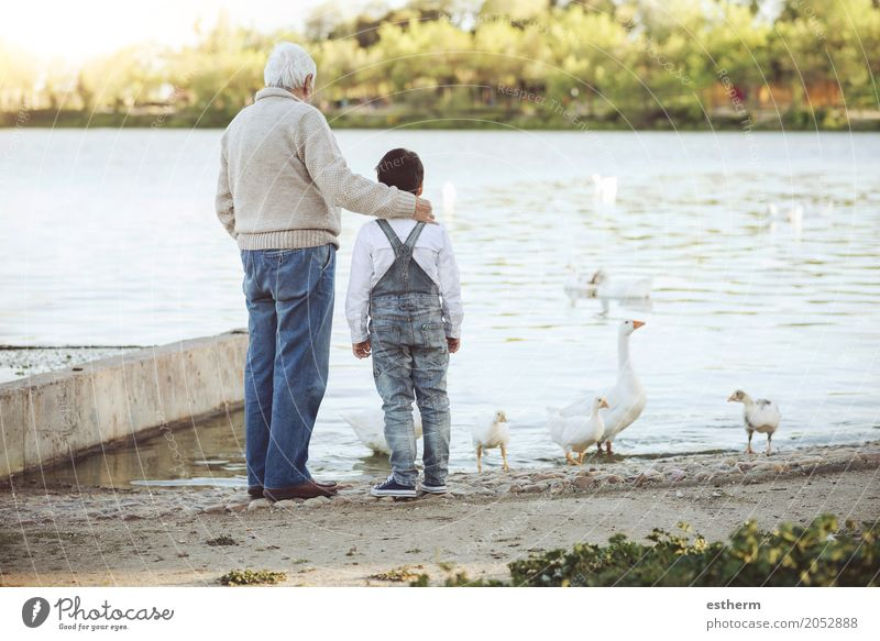 Grandfather With His grandson on the lake. Back view Human being Child Man Joy Lifestyle To talk Love Senior citizen Boy (child) Family & Relations Lake