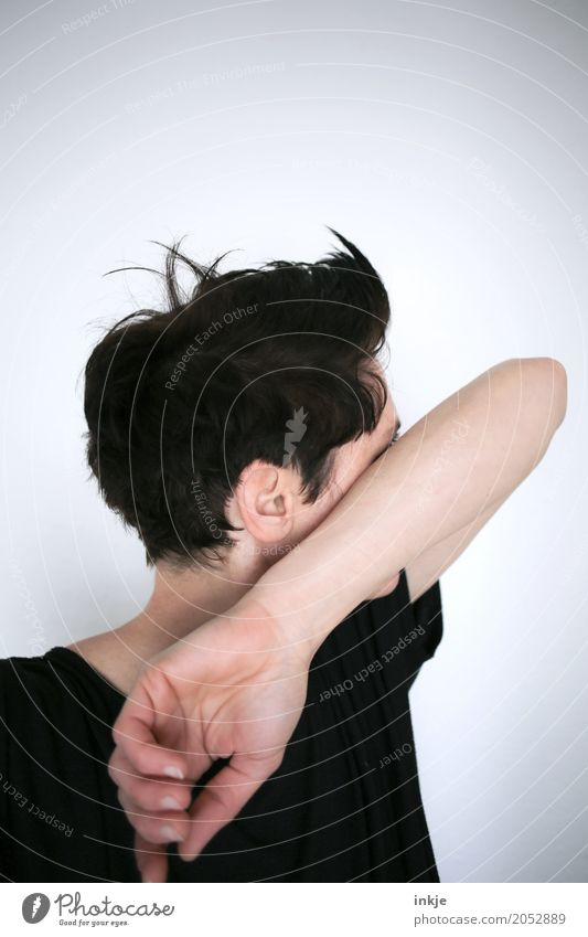 Woman with short hair hides her face behind her arm Lifestyle Style Hair and hairstyles Leisure and hobbies Adults Head Arm 1 Human being 30 - 45 years