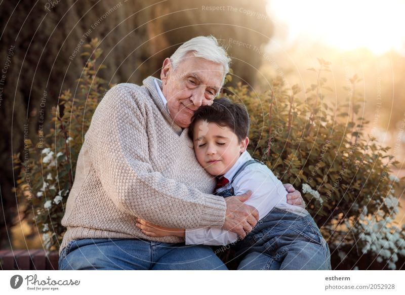 Portrait of grandfather and grandson embracing Lifestyle Human being Masculine Child Toddler Boy (child) Grandparents Senior citizen Grandfather