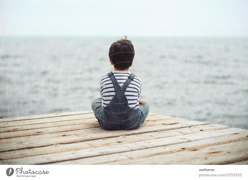 Thoughtful child sit at waterfront. Back view Lifestyle Human being Child Toddler Boy (child) 1 3 - 8 years Infancy Fitness Vacation & Travel Dream Sadness