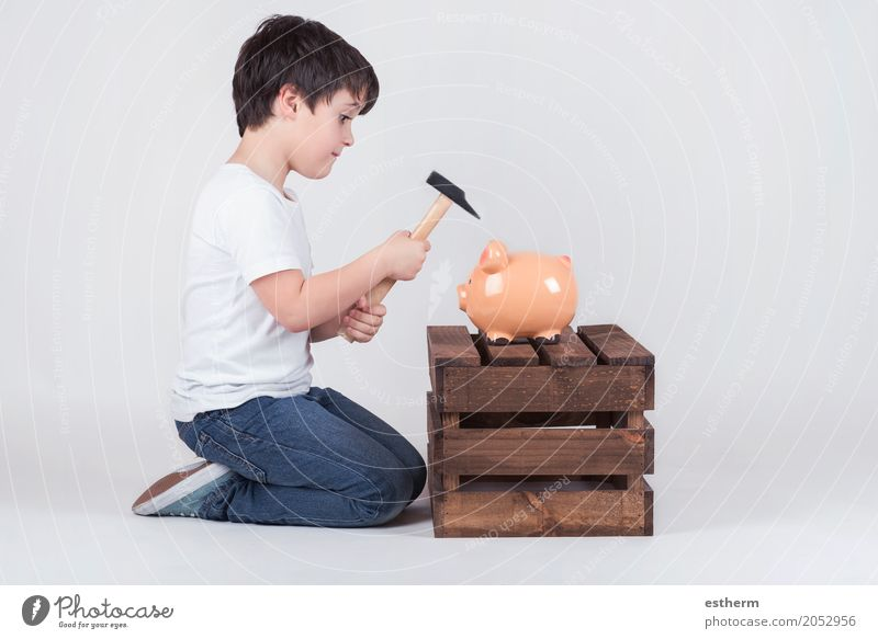 Little boy, His breaking piggy bank Human being Child Lifestyle Boy (child) Business Infancy Shopping Money Financial institution Luxury Economy Toddler