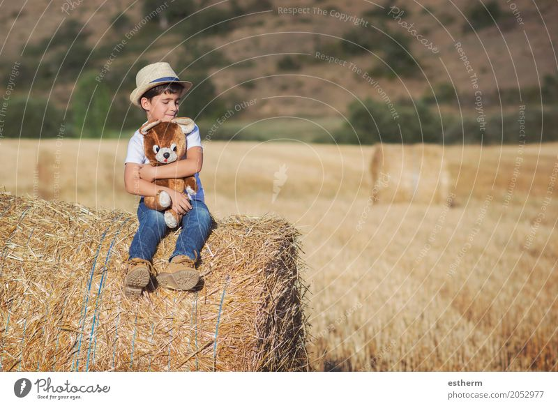 Boy hugging teddy bear in the wheat field Human being Child Nature Vacation & Travel Joy Lifestyle Love Emotions Meadow Funny Laughter Playing Freedom Think
