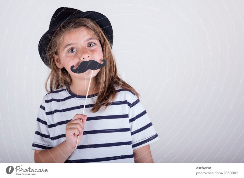 Beautiful cute little girl playing with mustache Human being Child Joy Girl Adults Lifestyle Love Funny Feminine Laughter Family & Relations Happy