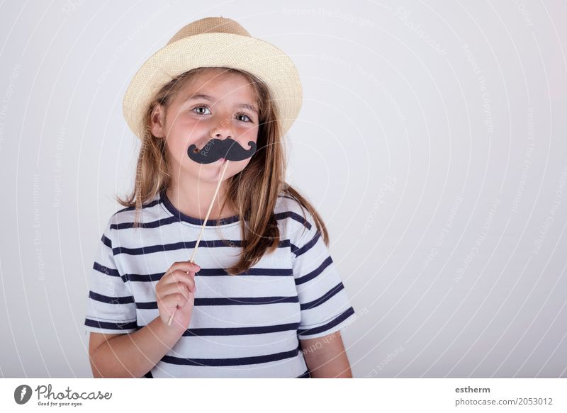 Beautiful cute little girl playing with mustache Human being Child Joy Girl Adults Lifestyle Love Funny Laughter Family & Relations Feasts & Celebrations