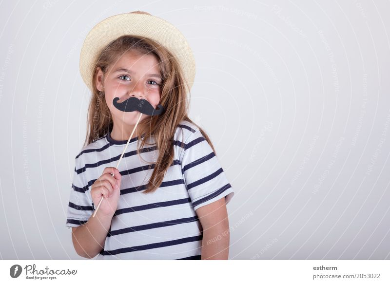 Beautiful cute little girl playing with mustache Human being Child Joy Girl Lifestyle Love Emotions Laughter Family & Relations Small Happy Feasts & Celebrations Together Friendship Infancy Happiness