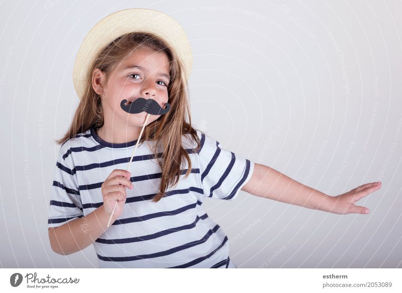 Beautiful cute little girl playing with mustache Human being Child Joy Girl Adults Lifestyle Love Emotions Feminine Laughter Family & Relations Small Party Feasts & Celebrations Friendship Infancy