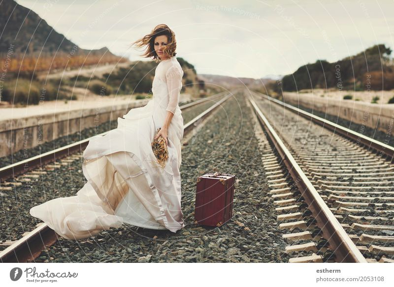 Pensive bride with a red suitcase on the train tracks Human being Vacation & Travel Youth (Young adults) Young woman Beautiful Joy Adults Lifestyle Love