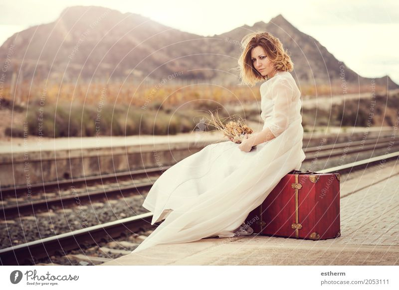 Pensive bride with a red suitcase on the train tracks Human being Woman Vacation & Travel Youth (Young adults) Young woman Beautiful Loneliness Joy Adults