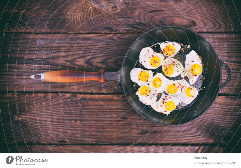 Fried quail eggs Dish Eating Yellow Natural Brown Above Retro Herbs and spices Kitchen Breakfast Meat Meal Top Feed Pan Protein