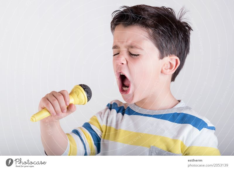 Boy singing to microphone Human being Child Joy Lifestyle Emotions Boy (child) Happy Party Moody Power Infancy Music Happiness To enjoy Cool (slang) Event