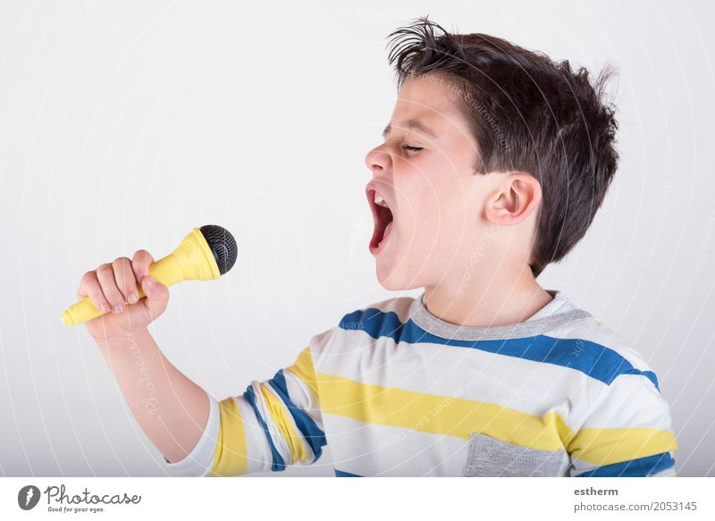 Boy singing to microphone Human being Child Joy Lifestyle Emotions Boy (child) Happy Moody Infancy Music Success Happiness Smiling To enjoy Stage play Toddler
