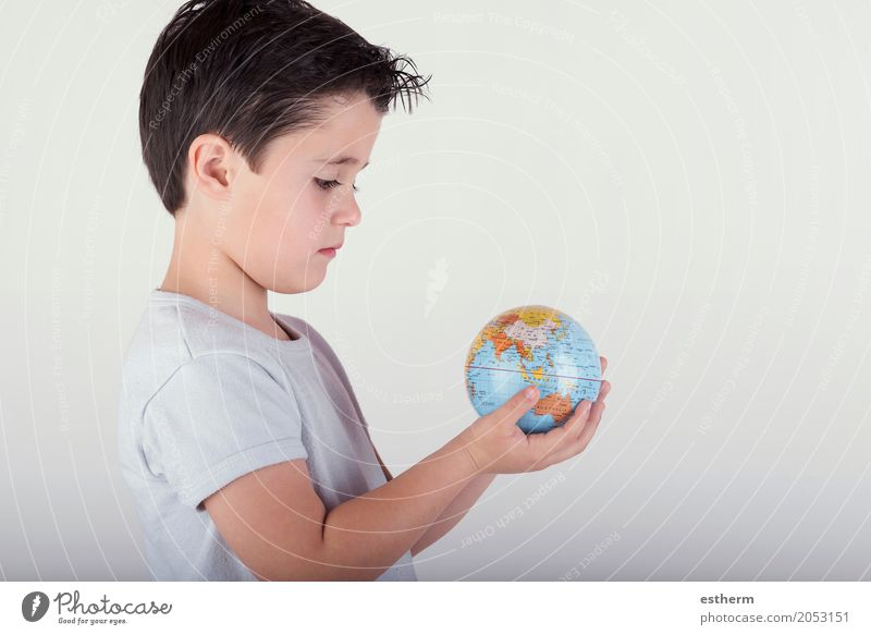 Boy looking at a toy globe. child holding earth in hands Lifestyle Human being Masculine Child Toddler Boy (child) Infancy 1 3 - 8 years Sphere Globe