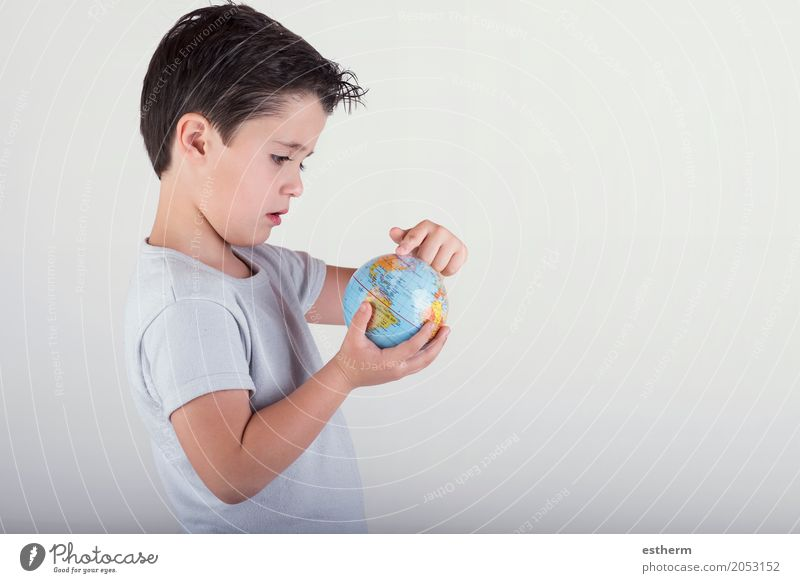 Boy looking at a toy globe. child holding earth in hands Human being Child Vacation & Travel Lifestyle Boy (child) Earth Tourism Masculine Trip Infancy