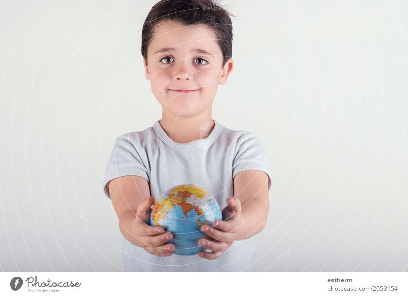 child holding earth in hands Lifestyle Human being Masculine Child Toddler Boy (child) Infancy Hand Fingers 1 3 - 8 years Sphere Globe Smiling Vacation & Travel