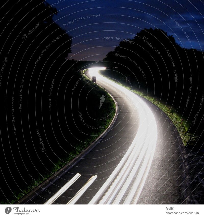 White Street Speed Illuminate Stripe Traffic infrastructure Driving Road traffic Car headlights Car lights Traffic lane Night shot Curved Tracer path Strip of light Structures and shapes