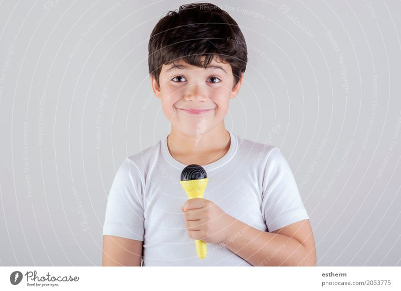 Boy singing to microphone Lifestyle Joy Leisure and hobbies Human being Child Toddler Boy (child) Infancy 1 3 - 8 years Stage play Music Singer Smiling Laughter