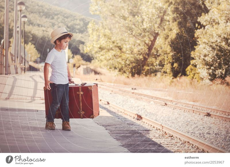 Boy with suitcase waiting for the train Human being Child Vacation & Travel Joy Lifestyle Emotions Boy (child) Freedom Tourism Trip Transport Infancy Happiness