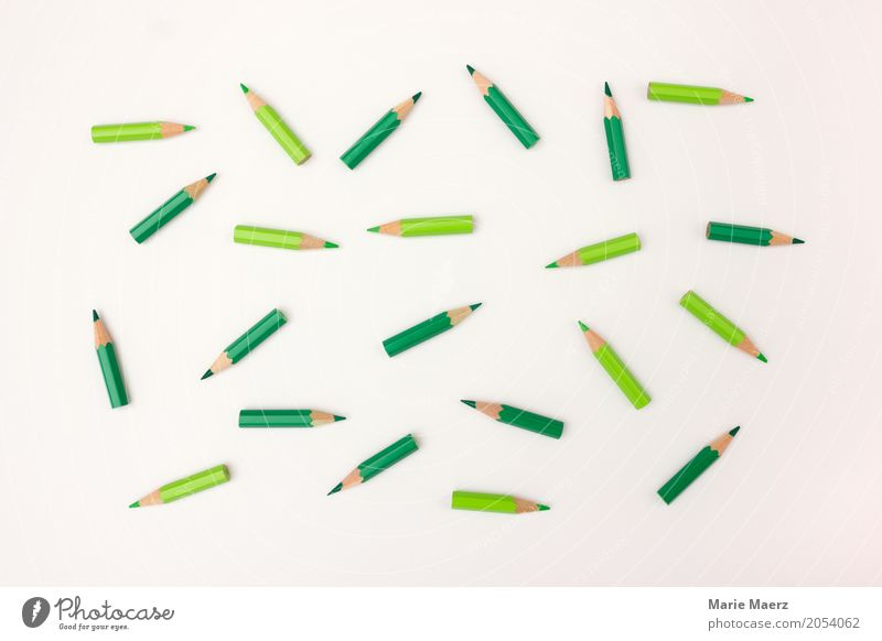 lying around Stationery Pen Observe Lie Together Many Green Movement Chaos Planning Teamwork Dynamics Coordination Untidy Colour photo Studio shot