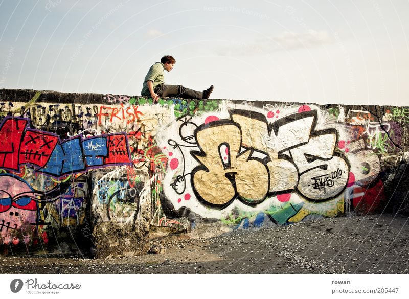 Human being Youth (Young adults) Wall (building) Wall (barrier) Graffiti Masculine Sit Change Culture Decline Trashy Manmade structures Multicoloured Street art Colour