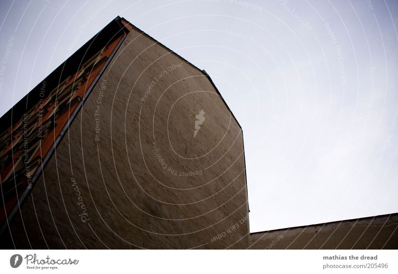 Sky House (Residential Structure) Loneliness Dark Wall (building) Wall (barrier) Building Architecture Facade Gloomy Manmade structures Plaster Sharp-edged Old building Cloudless sky