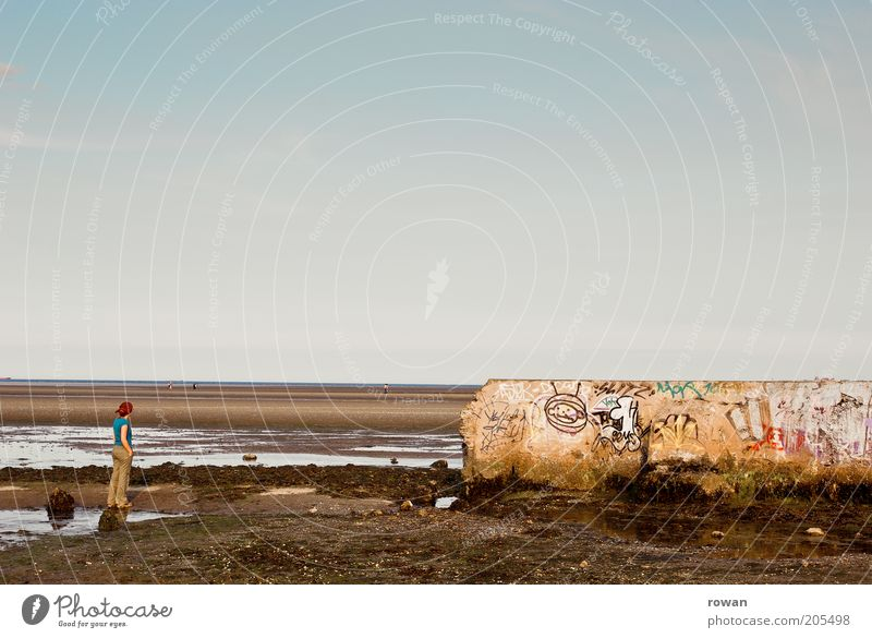 outlook Human being 1 Coast Beach Ocean Wall (barrier) Wall (building) Graffiti Looking Stand Dream Sadness Broken Gloomy Transience Mud flats Low tide