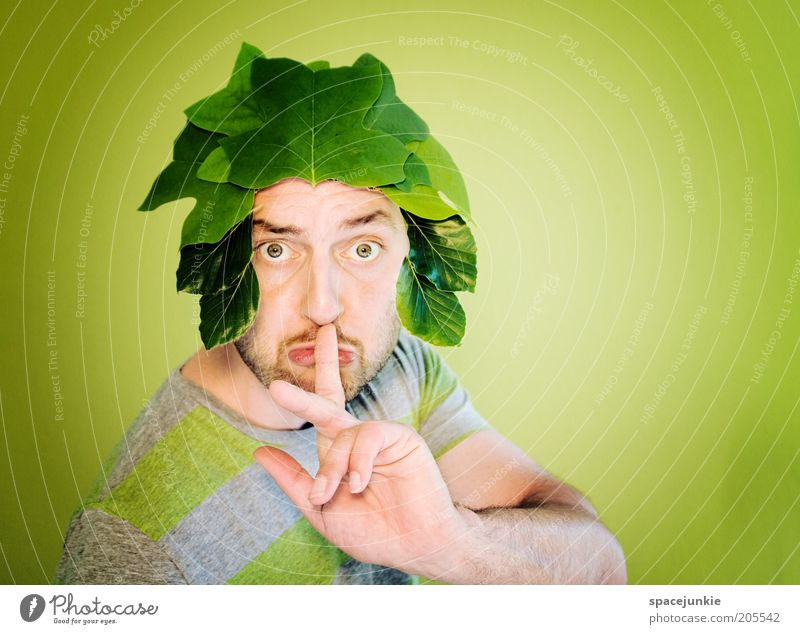 Shh... Shh. Masculine Man Adults Head Eyes Facial hair Fingers 1 Human being 30 - 45 years Plant Leaf Foliage plant Green Wig Calm Colour photo Interior shot