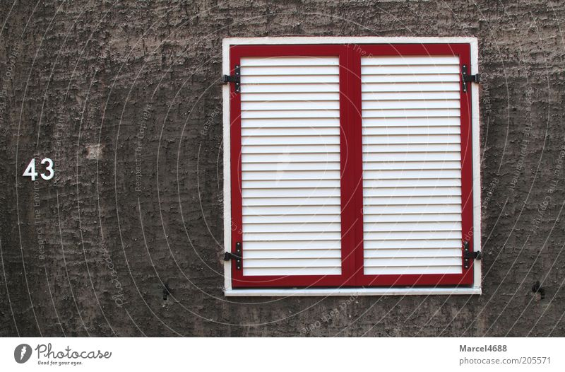Tight bulkheads Facade Window Sharp-edged Gloomy Gray Red White 43 Disk Exterior shot Close-up Structures and shapes Deserted Day Shutter Digits and numbers