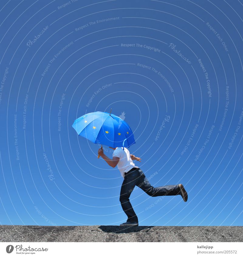 european balancing act Success Human being Masculine Man Adults 1 Movement Contentment Europe European flag Umbrella Balance Stability Safety Colour photo