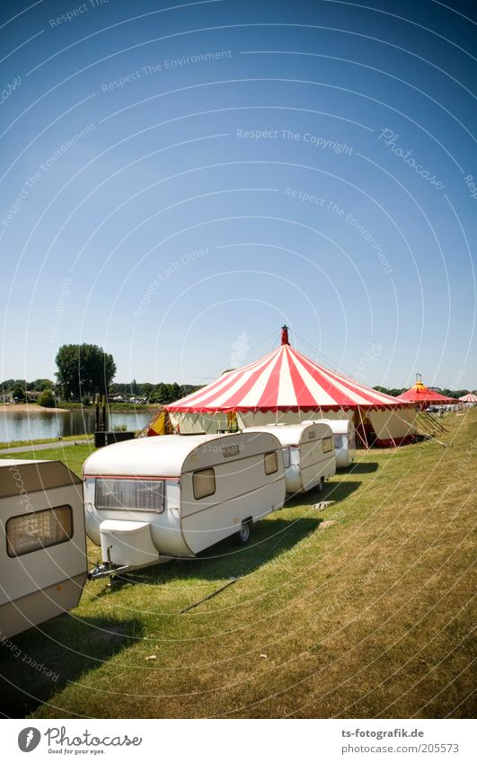 Wandering circus traffic jam Entertainment Event Music festival Feasts & Celebrations Fairs & Carnivals Sky Summer Beautiful weather Grass Coast River bank