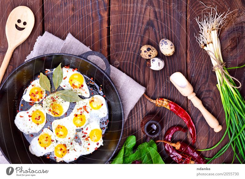 Fried quail eggs Herbs and spices Breakfast Lunch Dinner Pan Spoon Kitchen Restaurant Eating Fresh Natural Above Multicoloured Tradition Onion Dish lettuce