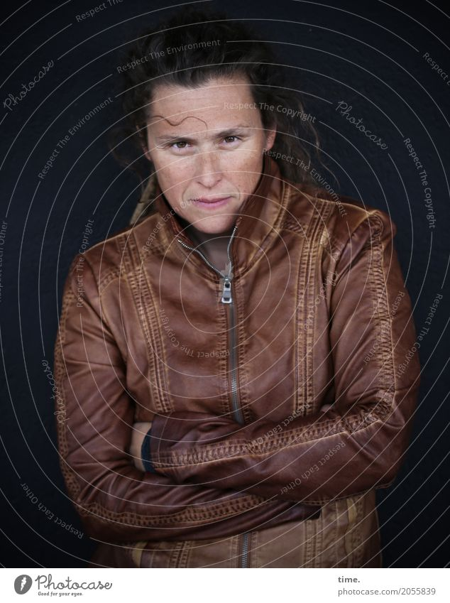 AST 10 | Sista Feminine Woman Adults Human being Wall (barrier) Wall (building) Jacket Leather Leather jacket Brunette Long-haired Observe Think To hold on