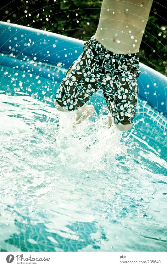 Human being Youth (Young adults) Water Blue Summer Joy Vacation & Travel Jump Playing Movement Legs Masculine Wet Swimming pool